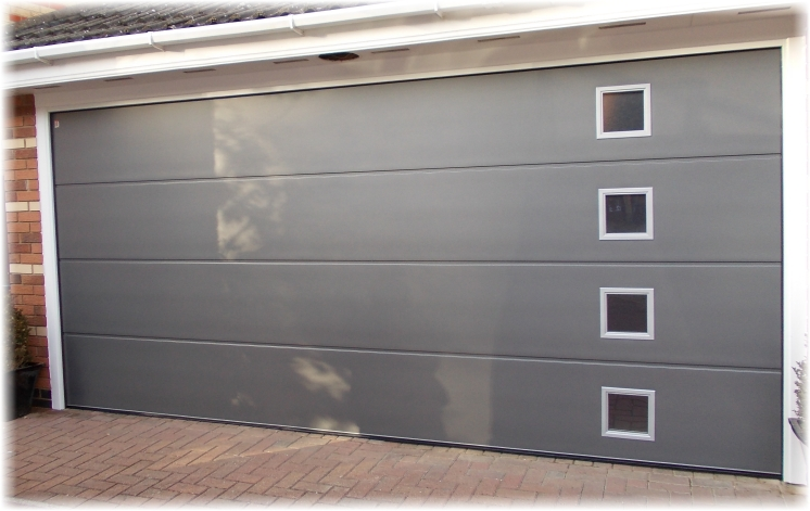 a carteck sectional door with square glazing