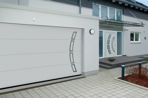 household front door with matching garage on front of european house in england UK
