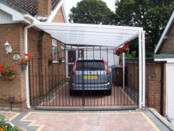 white car port in aluminium