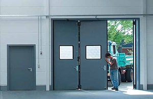 Industrial folding door with glazed sections