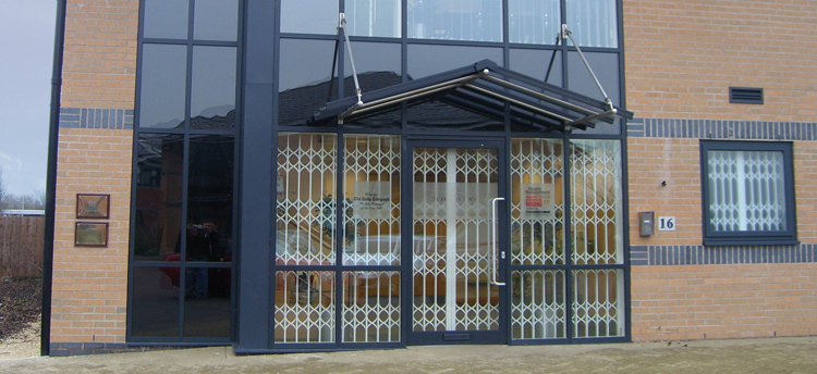 Security grilles retractable by samson doors