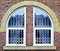 Seceuroguard grilles behind arched windows