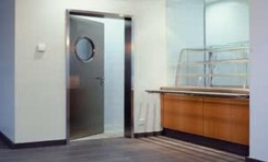 OIT multipurpose door with porthole circular windowed section in aluminium in catering kitchen facility
