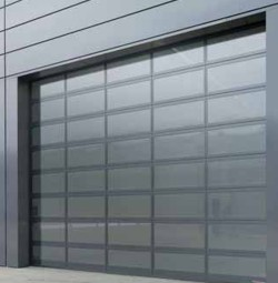Hormann ALR Vitraplan glass sectional door installed on industrial building