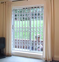 domestic retractable grille for security on a patio door